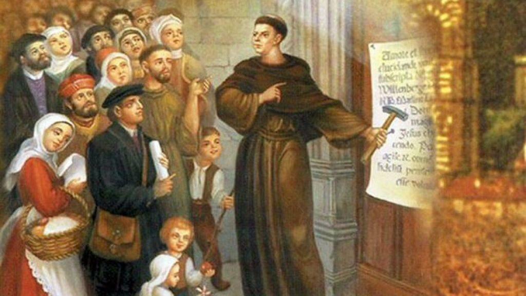 Мартин Лютер прибивает к церковной двери свои тезисы