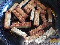 Фото приготовления рецепта: Гренки с чесноком - шаг №4